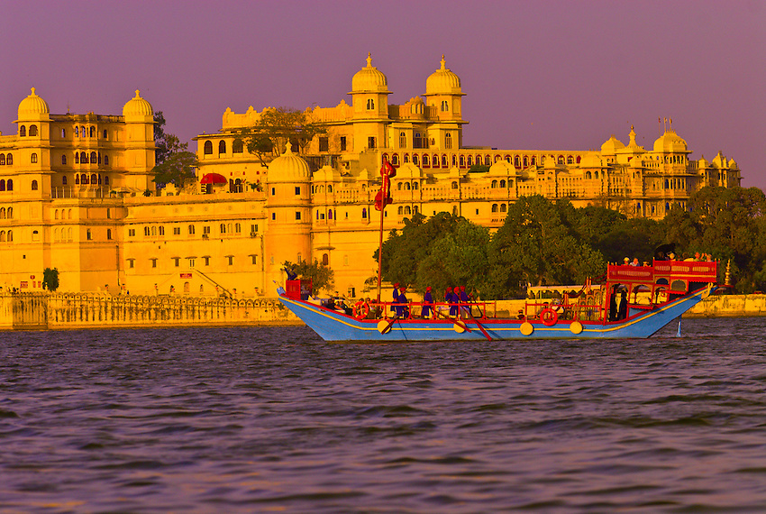 Gangaur boat (Royal barge) from the Lake Palace Hotel, at sail on Lake Pichola (with the City Palace in the background), Udaipur, Rajasthan, India