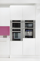 A bank of De Dietrich kitchen appliances includes an oven, steam oven, microwave and a coffee machine