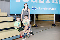 Anne-Marie Evans and her sons Carter, 7, and Luke, 5, (blond) Mussman pose for a portrait during a campaign rally for Democratic presidential nominee Hillary Clinton in the Theodore R. Gibson Health Center at Miami Dade College-Kendall Campus in Miami, Florida, USA. Former Vice President Al Gore also spoke at the rally.