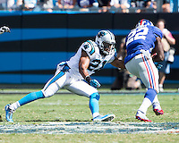 The Carolina Panthers played the New York Giants at Bank of America Stadium in Charlotte, NC.  The Panthers won 38-0 for their first victory of the season.  The Giants dropped to 0-3.  Carolina Panthers strong safety Mike Mitchell (21), New York Giants running back David Wilson (22)