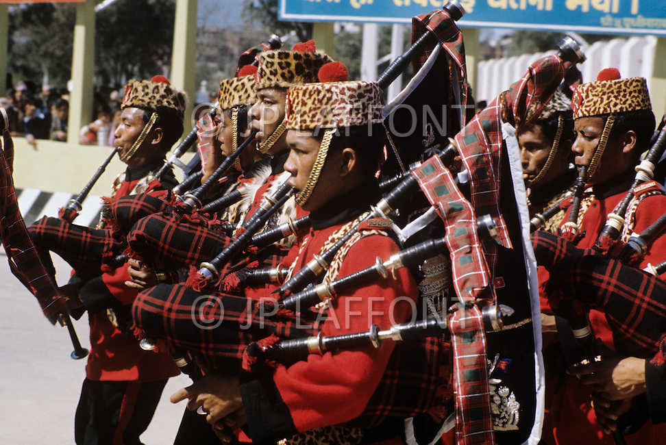 February 24th, 1975. Kathmandu. Nepal. The Coronation of King Birendra and Queen Aishwarya of Nepal, on the chosen day. At 8:37 a.m., the precise moment selected by court astrologers more than a year before, the royal priest placed the huge jewel-encrusted crown on the King's head and a diamond tiara atop Queen Aishwarya's. They were both massacred by their son Dipendra  on 1 June 2001. The Royal gards at the end of the coronation parade.