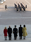 Washington, DC - January 20, 2009 -- United States President Barack Obama and his wife, Michelle, alongside US Vice President Joe Biden and his wife, Jill, exit the US Capitol participate in a military review to begin the parade after Obama was sworn in as the 44th US president in Washington, DC, on January 20, 2009. .Credit: Saul Loeb - Pool via CNP
