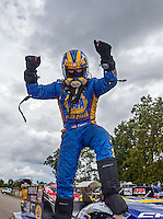 Aug 20, 2016; Brainerd, MN, USA; NHRA funny car driver Ron Capps celebrates after winning the Protect the Harvest Nationals from Seattle, WA that was delayed by rain to run during qualifying for the Lucas Oil Nationals at Brainerd International Raceway. It was the 50th win of Capps career. Mandatory Credit: Mark J. Rebilas-USA TODAY Sports