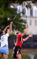 Kristen Carr (6) of North Carolina goes up for the ball against Karri Ellen Johnson (18) of Maryland during the ACC women's lacrosse tournament finals in College Park, MD.  Maryland defeated North Carolina, 10-5.