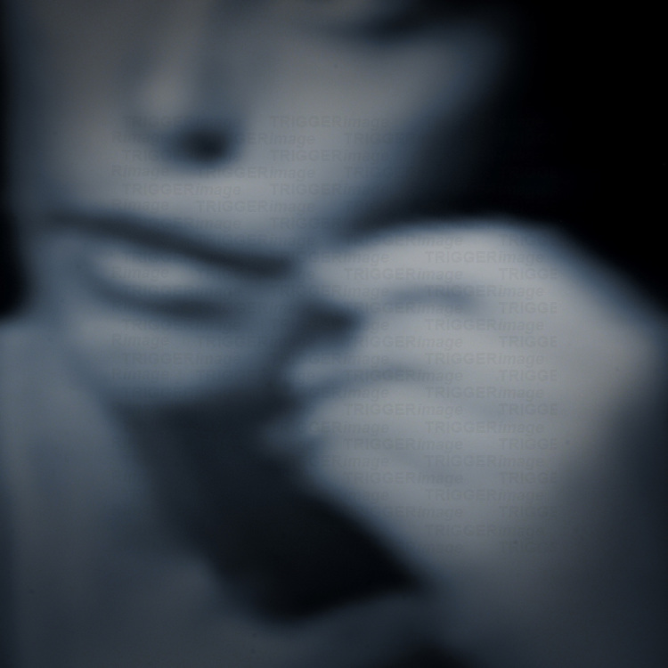 closely cropped image of a woman with her hand by her mouth