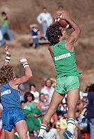 Actor Gregory Harrison catches pass during Football Game at the Battle of the Network Stars. Pepperdine University, Pepperdine CA. November, 1979. Photo by John G. Zimmerman.