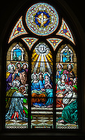A stained glass window at St. Mary Church in Luxemburg, Wis., depicts the Holy Spirit descending upon the apostles at Pentecost. (Sam Lucero   The Compass)