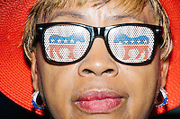 Louisiana delegate Sylvia Crier wears Democratic party donkey glasses on the final day of the Democratic National Convention at the Wells Fargo Arena in Philadelphia, Pennsylvania, on Thurs., July 28, 2016.