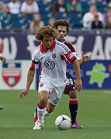 DC United midfielder Nick DeLeon (18) dribbles as New England Revolution defender Kevin Alston (30) defends. In a Major League Soccer (MLS) match, DC United defeated the New England Revolution, 2-1, at Gillette Stadium on April 14, 2012.