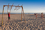 Teenager Boy Swinging on Pärnu Beach, Estonia