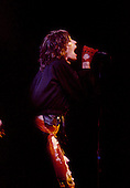 Chicago, Illinois<br /> July 23, 1975<br /> USA<br /> <br /> Lead singer Mick Jagger of the Rolling Stones performs live at Chicago Stadium during the band's &quot;Rolling Stones Tour of the Americas '75&quot;.<br /> <br /> This was the Stones first tour with new guitarist Ronnie Wood, after Mick Taylor left the band. The Stones, with their usual act freshly aided by theatrical stage props including a giant inflatable phallus (nicknamed 'Tired Grandfather' by the band, since it sometimes malfunctioned) and, at the Chicago shows, an unfolding lotus flower-shaped stage that Charlie Watts had conceived.<br /> <br /> The band was composed of  Mick Jagger - vocals, guitar, harmonica, Keith Richards - guitar, vocals, Bill Wyman - bass guitar, and Charlie Watts - drums, percussion. <br /> <br /> Additional musicians included: Ronnie Wood - guitar, backing vocals, Ian Stewart - piano, Billy Preston - keyboards, vocals and Ollie Brown - percussion.