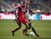 Austin Berry (22) of the Chicago Fire holds the ball away from Sebastien Le Toux (11) of the Philadelphia Union during a Major League Soccer match at PPL Park in Chester, PA.  Philadelphia defeated Chicago, 1-0.