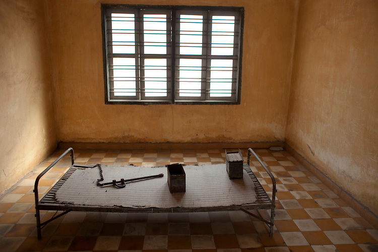 Iron bed formerly used for prisoners at the Toul Sleng Genocide Museum in Phnom Penh, Cambodia. <br /> Photos &copy; Dennis Drenner 2013.