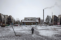 A view of a square in the village of Verkhnezeysk, which today has a population of 1,500. In Soviet times, the town had a summer youth camp, now converted into housing. In the background is the power station that provides heat to the settlement. People in places like this rely heavily on the medical services offered by the Matvei Mudrov medical train. <br /> <br /> The Matvei Mudrov train is a medical train operated by Russian Railways along the course of the Baikal Amur Magistral (Baikal-Amur Mainline, or BAM) railway line. Named after a famous 19th century Russian physician, the train employs around 15 doctors who make about 10 trips a year, each lasting two weeks. Along the way they deliver essential medical services to people living in remote villages along the 4,324 km long BAM railway. Though not equipped to carry out surgical procedures the train has heart monitors, ultrasound and x-ray machines to deliver diagnosis.