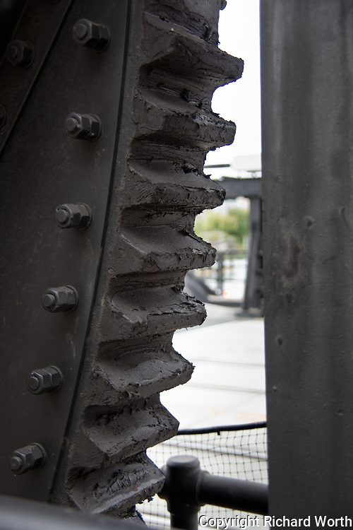 The massive teeth of a gear on the 4th Street Bridge in San Francisco.