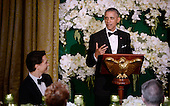 United States President Barack Obama makes remarks as Prime Minister Justin Trudeau of Canada looks on during a toast at the state dinner honoring the Prime Minister and Mrs. Sophie Gr&eacute;goire Trudeau at the White House March 10, 2016 in Washington, DC. <br /> Credit: Olivier Douliery / Pool via CNP