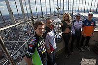 """New York, USA. 23 April 2014.  Supercross motorcycle racers (L-R) Adam Cianciarulo, Mike Alessi, """"Miss Supercross"""" Dianna Dahlgren, Chad Reed and Ken Roczen promote their motorcycle race during a visit to the Empire State Building in New York. Photo by Eduardo Munoz Alvarez/VIEWpress"""