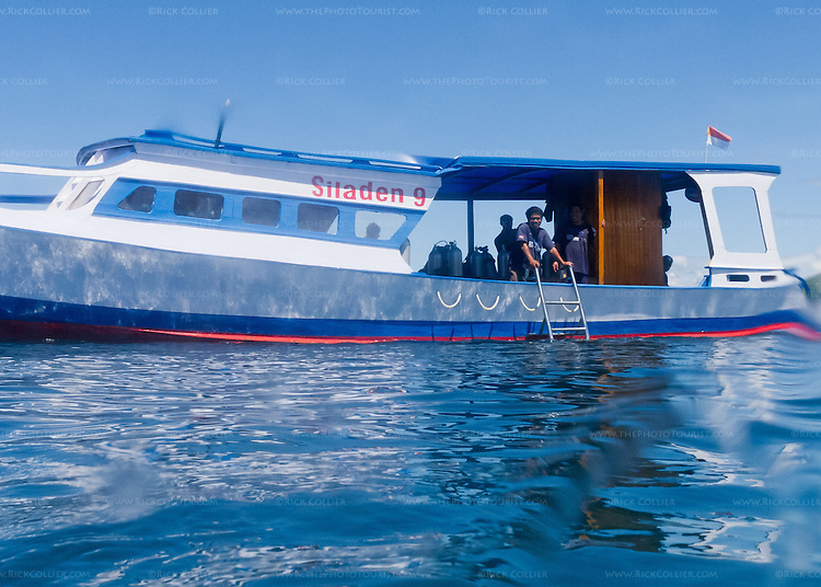 "The crew of Siladen Resort and Spa boat ""Siladen 9"" drop the ladder to pick up the photographer and other divers in Bunaken National Park, off North Sulawesi, Indonesia."