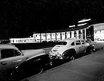 Moon Township PA:  View of the main entrance and Taxi cabs waiting for a fare on opening night at the new Greater Pittsburgh Airport - 1952. In 1944, Allegheny County officials proposed to expand the military airport with the addition of a commercial passenger terminal in order to relieve the Allegheny County Airport, which was built in 1926 and whose capacity was quickly becoming insufficient to support the growing demand for air travel.  The new airport, christened as Greater Pittsburgh Airport opened on May 31, 1952. The first flight occurred on June 3, 1952.