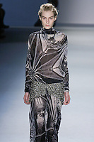 Julia Nobis walks runway in a black vault print silk chiffon long sleeve cowl neck gown with plunging back and crystal mesh belt over charcoal silk chiffon boy short, from the Vera Wang Fall 2012 Vis-a-gris collection, during Mercedes-Benz Fashion Week Fall 2012 in New York.
