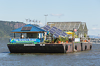 The Science Barge environmental education center anchored on the Hudson River on the waterfront of Yonkers, New York.