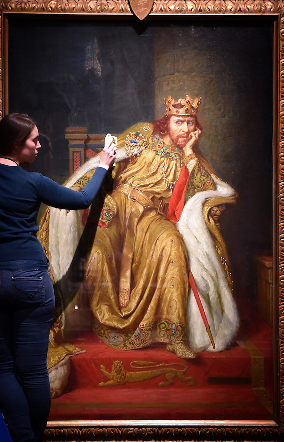 ALEX KAVANAGH, EXHIBITION OFFICER, POLISHES A PAINTING OF KING JOHN. PART OF THE BRITISH LIBRARY'S MAGNA CARTA: LAW, LIBERTY,LECACY EXHIBITION OPENING ON MARCH 13TH. PHOTO BY CLARE KENDALL. FOR FURTHER INFO CONTACT PRESS OFFICE 02074127110