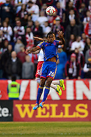 Deshorn Brown (26) of the Colorado Rapids goes up for a header with Armando (5) of the New York Red Bulls. The New York Red Bulls and the Colorado Rapids played to a 1-1 tie during a Major League Soccer (MLS) match at Red Bull Arena in Harrison, NJ, on March 15, 2014.