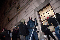 Protestors smash windows of the Treasury building during a student demonstration in Westminster, central London on the day the government passed a bill to increase university tuition fees.