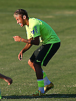 Neymar of Brazil laughs during training ahead of tomorrow's World Cup quarter final vs Colombia tomorrow
