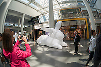 """Seven giant inflatable rabbit sculptures, entitled """"Intrude"""" by the Australian artist Amanda Parer go on display in Brookfield Place in Lower Manhattan in New York on Sunday, April 17, 2016. Organized by Arts Brookfield the nylon monumental sculpture displays the humor of over-sized bunnies revealing the more serious side of an environmental problem as rabbits are an invasive species in Australia.  (© Richard B. Levine)"""