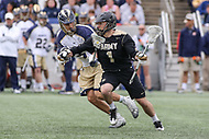 Annapolis, MD - April 15, 2017: Army Black Knights Matt Manown (1) keeps the Navy Midshipmen defender away from the ball during game between Army vs Navy at  Navy-Marine Corps Memorial Stadium in Annapolis, MD.   (Photo by Elliott Brown/Media Images International)