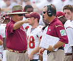 Florida State head coach Bobby Bowden, left, has a disagreement with offensive coordinator and head coach in waiting Jimbo Fisher after former Lincoln High standout and Bulls quarterback B.J. Daniels drove his unranked team the full length of the field for their first touchdown in the first half of a 17-7 defeat of the Seminoles in their NCAA football game in Tallahassee, Florida September 26, 2009.  (Mark Wallheiser/TallahasseeStock.com)