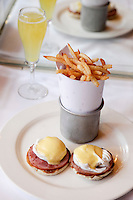 Eggs benedict and mimosa at The Odean in Manhattan...(April 2, 2011).Photo by Danny Ghitis