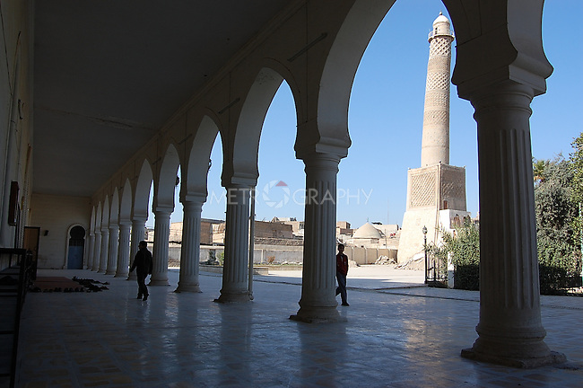IRAQ, MOSUL:  A view of the Hadba minaret (850 A.D.) seen through the arches of the Noori Kabil Mosque in Mosul...Photo by Bashar Adnan/Metrography