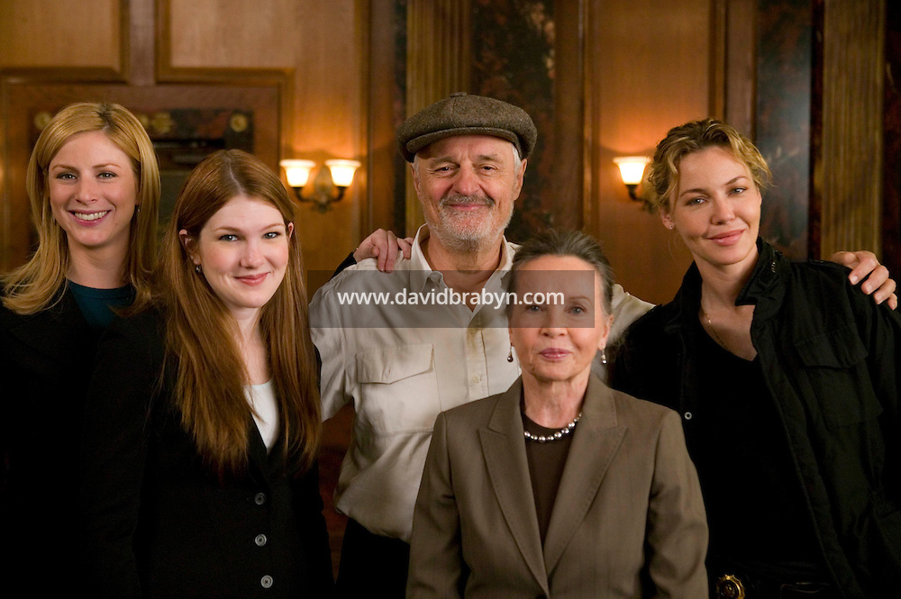 """8 May 2006 - North Bergen, NJ - French actress Leslie Caron (2R) poses with (LtoR, background) Diane Neal, Lily Rabe, Director Ted Kotcheff and Connie Nielsen, on the studio set of television show """"Law & Order: SVU"""" in North Bergen, USA, 8 May 2006. In this rare appearance in front of American television cameras, Caron, 74, plays a French victim of past sexual molestation in an episode entitled """"Recall"""" due to air in the fall. Caron starred in Hollywood classics such as """"An American in Paris"""" (1951), """"Lili"""" (1953), """"Gigi"""" (1958). More recently she appeared in """"Chocolat"""" (2000) and """"Le Divorce"""" (2003). Photo Credit: David Brabyn"""