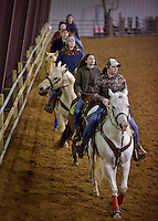 NWA Democrat-Gazette/BEN GOFF -- 02/01/15 Bailey Perdue of Siloam Springs leads a line through part of a routine during the Rodeo of the Ozarks Rounders practice in Isuba Valley Horse Park near Siloam Springs on Sunday, Feb. 1, 2015.