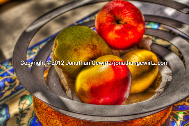 A bowl of fruit photographed using HDR techniques.