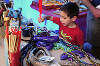 Mesa, Arizona. November 4, 2012 - A small boy who attended the 18th Annual Asian Festival 2012 looks at some traditional Asian toys at one of the booths that sold merchandise during the event that took place at the Mesa Arts Center. In Arizona, Asian-Americans celebrated a colorful festival where their rich culture was admired and their growing presence affirmed. Asian-Americans are now the United States fastest-growing racial group, the best-educated and highest-earning workers. Photo by Eduardo Barraza © 2012