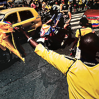 A Colombian man sells football fan flags on the street in Cali, Colombia, 28 June 2014.