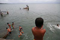 Boys jump in the sea from a damaged pier in the coastal part of Tacloban that was destroyed by Typhoon Haiyan January 16, 2015. On his first visit to Asia's largest Catholic nation, Pope Francis will visit the central province of Leyte, which is still struggling to recover from Typhoon Haiyan that killed 6,300 people in 2013. About two million people are expected to attend an open-air mass on Saturday at Tacloban City airport, almost completely destroyed by Haiyan. REUTERS/Damir Sagolj (PHILIPPINES)