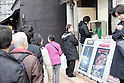March 11, 2011, Tokyo, Japan - People wait in line to make calls on the public telephone following aftereffects of Friday's powerful earthquake that shook Japan's northern area on March 11, 2011. Tsunami waves hit northern Japanese prefectures after the quake with a magnitude of 8.9 struck Miyagi prefecture, causing damages even in the Tokyo Metropolitan area. (Photo by Akihiro Sugimoto/AFLO) [1080] -mis-
