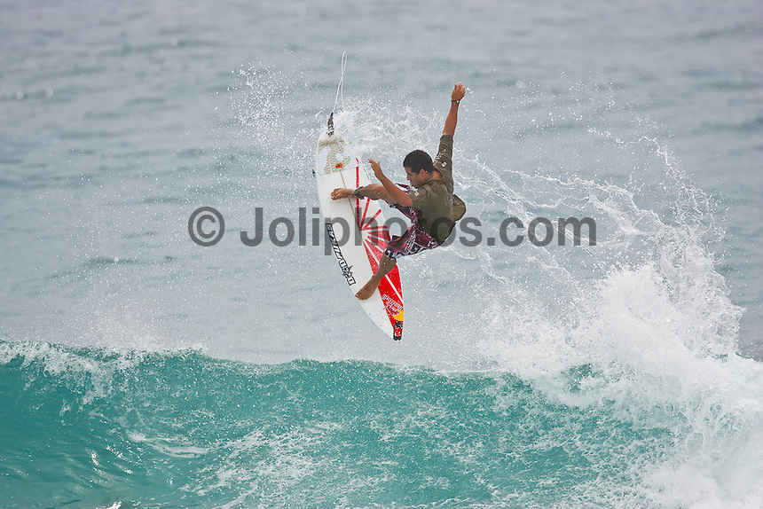 """Adriano de Souza (BRA) free surfing at D-Bah during the tsunami warning. COOLANGATTA, Queensland/Australia (Sunday, February 28, 2010) - A magnitude 8.8 earthquake struck off the coast of Chile early Saturday morning, resulting in a tsunami warning for the East Coast of Australia effective today.  Event organisers, coordinating with the Australian Government Bureau of Meteorology, were forced to call both the Quiksilver Pro Gold Coast presented by Land Rover and the Roxy Pro Gold Coast events for the day, with the potential tsunami projected to hit at 8:15am.     """"We've been monitoring the situation with chief meteorologists throughout the night and all projections are indicating the effects to hit the Gold Coast at approximately 8:15am,"""" Rod Brooks, Quiksilver Pro Contest Director, said. """"What those effects will be, we cannot be sure. We've been advised that the biggest surge could hit anywhere from six to 12 hours after the initial surge, so we've called competition off for the day. The event site is closed for the day, and we'll check back tomorrow at 6:30am."""" Photo: joliphotos.com"""