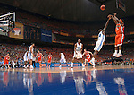 04 APR 2005: Guard Dee Brown (11) of the University of Illinois puts up a three point shot attempt in front of UNC's Marvin Williams (24) during the Men's Division I Basketball Championships held at the Edward Jones Dome in St. Louis, MO. The University of North Carolina went on to defeat the University of Illinois 75-70 to claim the championship title. Photo: Rich Clarkson/NCAA Photos