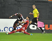 Gonzalo Segares (13) of the Chicago Fire goes against Sainey Nyassi (27) of D.C. United.  The Chicago Fire defeated D.C. Untied 3-0, at RFK Stadium, Friday October 4 , 2013.