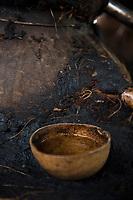 Testing recently distilled mezcal, 70% alchohol. Felix Garcia a Maestro Mezcalero at his ranch and distillery in El Potrero, Oaxaca, Oaxaca, Mexico
