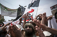 In this Friday, Jul. 12, 2013 photo, Muslim supporters of the ousted president Mohammed Morsi demostrate after praying in Al Rabaa mosque in Nasr City, Cairo. (Photo/Narciso Contreras).