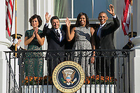 US President Barack Obama (R), First Lady Michelle Obama (2R), Italian Prime Minister Matteo Renzi (2L) and Italian First Lady Agnese Landini (R) wave from the Truman Balcony at the conclusion of an official arrival ceremony on the South Lawn of the White House in Washington DC, USA, 18 October 2016. Later today President Obama and First Lady Michelle Obama will host their final state dinner featuring celebrity chef Mario Batali and singer Gwen Stefani performing after dinner. <br /> Credit: Shawn Thew / Pool via CNP /MediaPunch