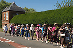 """Stowey Female Friendly Society ( The Womens Walk ) Club Day. Local women and flower girls walk from the village to the grave of Tom Poole ) founder 1806) at St Marys Church. Dress code """"formal, with hat and posy of flowers."""" Nether Stowey Somerset 2014."""
