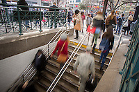 Crowds enter and leave the busy Union Square subway station in New York on Wednesday, March 11, 2015 (© Richard B. Levine)