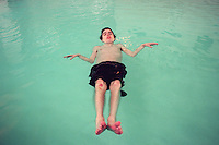 "When David Pyle is taken swimming each week, he floats- sometimes for the entire session.  Born both deaf and legally blind, David,32, never acquired any tactual ASL language skills.  In the water he experiences what therapists call ""body awareness""; a realization of his physical nature.  David attended the Washington State School for the Blind, then entered the Seattle School District's deaf-blind program.  He lives with a roomate in an apartment with 24-hour support services."